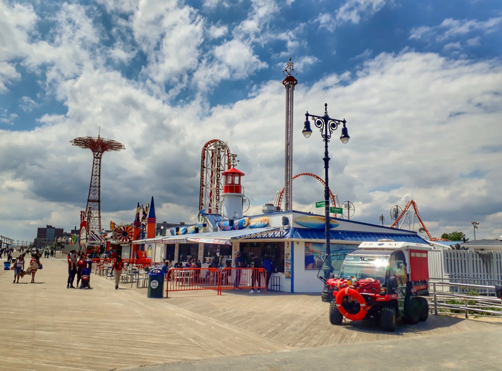 The Coney Island Boardwalk with Luna Park rides in the background